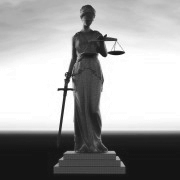 a marble statue of a Greek woman from ancient times holding a sword in her right hand and the scales of justice in her left hand.