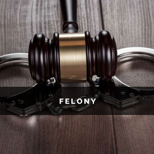 the head of a gavel on top of a pair of handcuffs